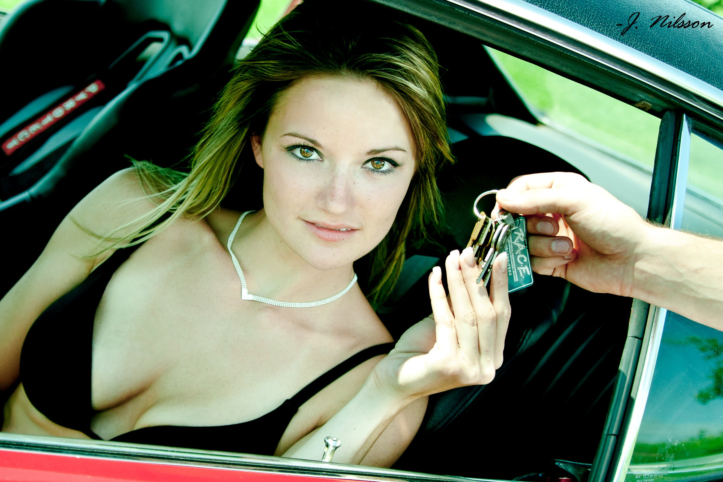 woman-in-muscle-car